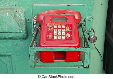 retro red telephone in asia street, India