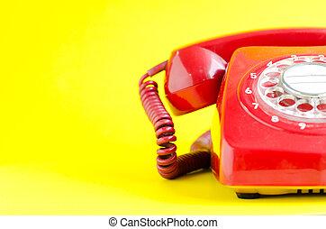 Retro Red Telephone on yellow Background