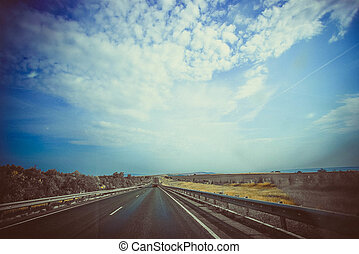 retro road with paper textures and a subtle vignette. - An...
