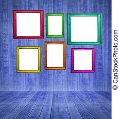 Retro room with colorful blank picture frames