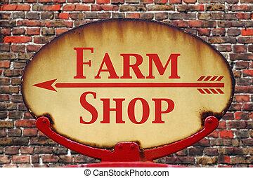 Retro sign Farm shop - A rusty old retro arrow sign with the...