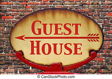 Retro sign Guest house - A rusty old retro arrow sign with...
