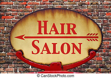 Retro sign Hair salon - A rusty old retro arrow sign with...