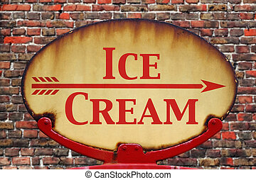 A rusty old retro arrow sign with the text Ice cream