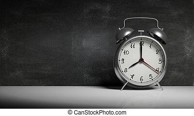 Retro silver alarm clock with blackboard and copy-space