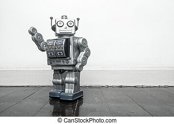 retro silver robot waving hi on an old wooden