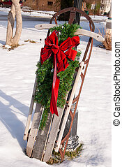 retro sled in snow with Christmas bow