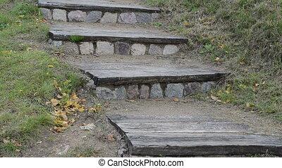 retro stair woman walk - closeup retro wooden stone stair in...