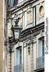 Retro street lantern on the house wall