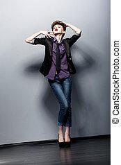 Retro Style. Emotions. Pin Up Fashion Girl posing in Studio. Glamor