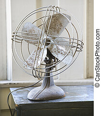 Retro style fan. - Retro style metal fan sitting on tabletop...