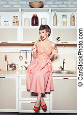 Retro style girl in the kitchen.