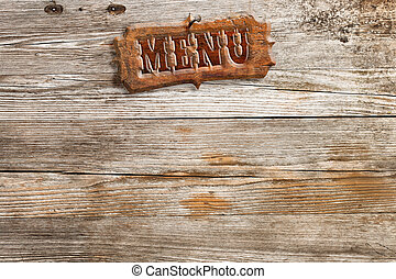 retro style menu sign nailed on aged wooden background