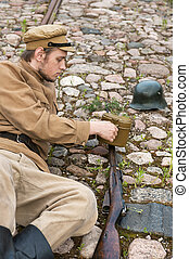 Retro style picture with resting soldier. - Soldier with gun...