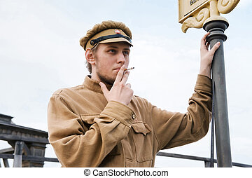 Retro style picture with smoking soldier. - Soldier with a...