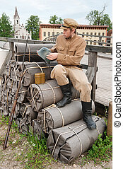 Retro style picture with soldier sitting on the bundles -...