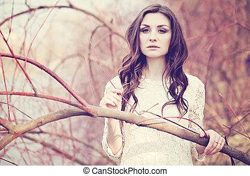 Retro Style Portrait of Beautiful Woman Outdoors