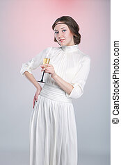 Retro style portrait of beautiful woman with wineglass
