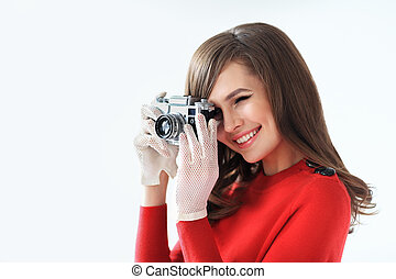 Retro style portrait of young beautiful woman taking photo ...
