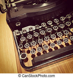 Close-up of a retro style typewriter on a table.