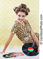Retro Style Woman With Vinyl Records - Portrait of young...