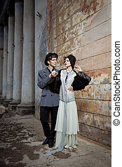 Retro styled fashion portrait of a young couple. Clothing ...