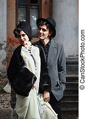 Retro styled fashion portrait of a young couple. Clothing...