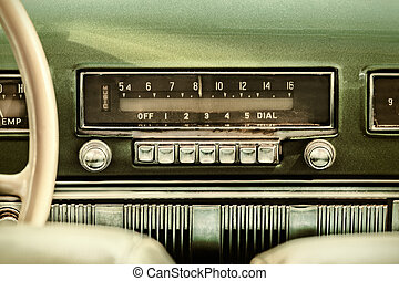 Retro styled image of an old car radio inside a green...