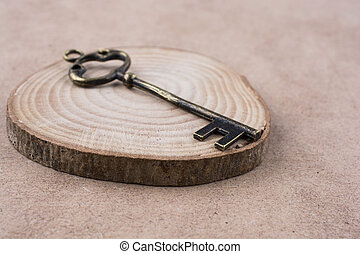 key on a piece of wood