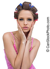 Retro styled model in hair curlers posing
