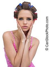 Retro styled model in hair curlers posing
