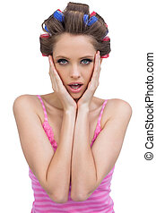 Retro styled model with hair curlers posing
