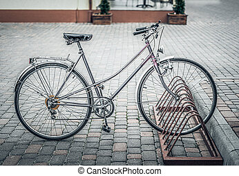 Retro styled sepia image of vintage bicycle