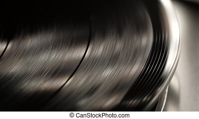 Retro-styled spinning record vinyl player. Close up. ...