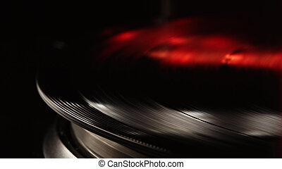 Retro-styled spinning record vinyl player. Close up. Rotating vintage phonograph close up. Beautiful colorful movie.
