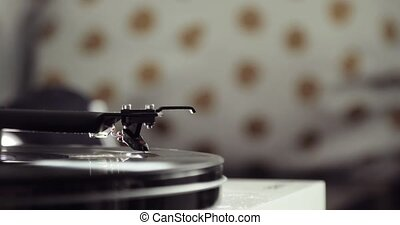 Retro-styled spinning record vinyl player on blur...