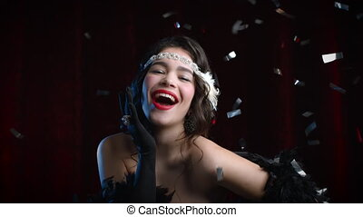 Retro styled woman dressed in Gatsby era posing and smiling ...