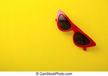 Retro sunglasses on yellow background