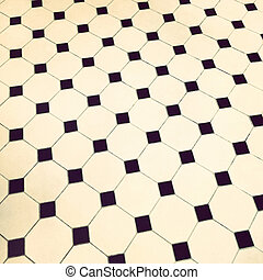 Retro tile floor - Close-up of black and white retro tile ...