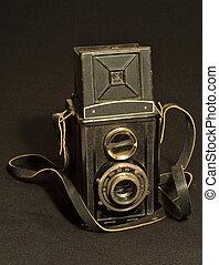 retro TLR (Twin-lens reflex) photo camera on black fabric TO...