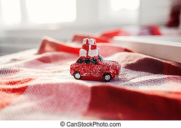 retro toy car delivering Christmas gifts