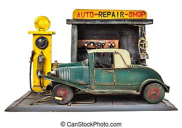 Retro toy car repair shop isolated on white - Retro toy car...