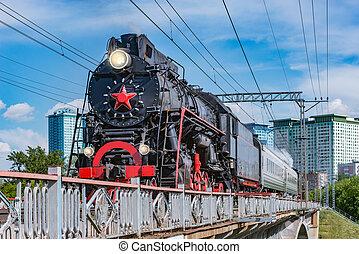 Retro train moves on the bridge. Moscow.