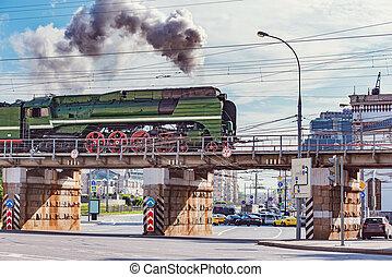 Retro train moves on the bridge. Moscow. Russia.