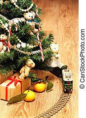 train under tree gift