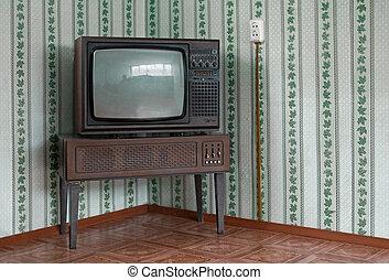 Retro tv set - Retro grunge tv against wallpaper wall.
