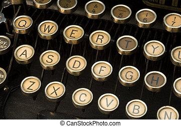 typewriter - retro typewriter closeup on QWERTY keys