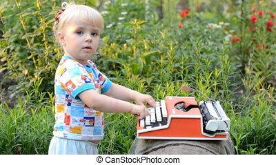 Retro Typewriter Machine in use. Little Girl Writer Printing...