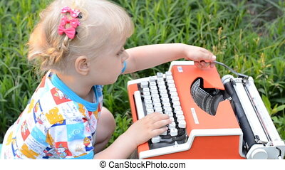 Retro Typewriter Machine in use. Little Girl Writer Printing in a Garden.