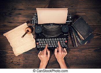 Retro typewriter on wooden planks - Retro typewriter placed...